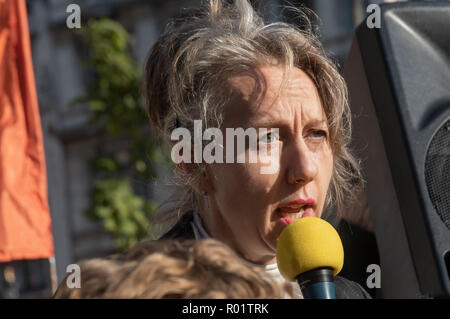 London, UK. 31st October 2018. Dr Gail Bradbrook speaks at the Extinction Rebellion protest in Parliament Square. Other speeches were from climate activists including  Swedish schoolgirl Greta Thunberg, campaigner Donnachadh McCarthy, Labour MP Clive Lewis and economist and Green MEP Molly Scott Cato before making a 'Declaration of Rebellion' against the British Government for its criminal inaction in the face of climate change catastrophe and ecological collapse. Credit: Peter Marshall/Alamy Live News - Stock Image
