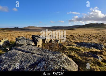 Dartmoor moorland with granite boulders and looking across open moors toward Oke Tor, Devon - Stock Image