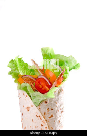 Tortilla wrap with vegetables and meat. - Stock Image