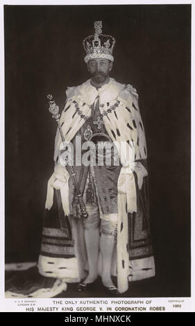 King George V in coronation robes, holding the orb and sceptre.      Date: 1911 - Stock Image