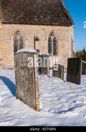 The village church at Bitchfield, Grantham, Lincolnshire in the snow - Stock Image