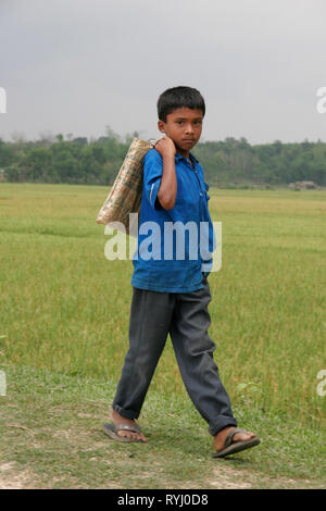 BANGLADESH Boy walking to school. Near Mymensingh photo by Sean Sprague - Stock Image