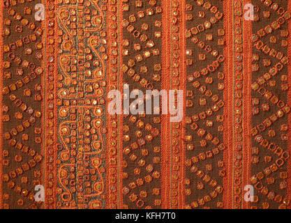 Indonesian textile with gold metallic thread applique. Sumatra  Southeast Asia - Stock Image