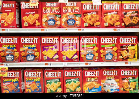 Shelves full of Cheez-It for sale in a grocery store in Speculator, NY USA - Stock Image