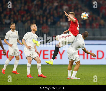 Optus Stadium, Burswood, Perth, W Australia. 17th July 2019. Manchester United versus Leeds United; pre-season tour; Scott McTominay of Manchester United is fouled by Kemar Roofe of Leeds United making a back for him Credit: Action Plus Sports Images/Alamy Live News - Stock Image