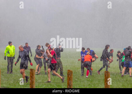 Northampton, UK. 9th March 2019. After a sunny start to the day, heavy rain came in midmorning soaking the people doing their keep fit classes in Abington Park. Credit: Keith J Smith./Alamy Live News - Stock Image