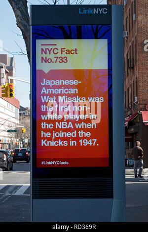 A message on a LINK NYC screen with the fun fact that the first non-white player in the NBA was Japanese American Wat Misaka. In Queens, NYC - Stock Image