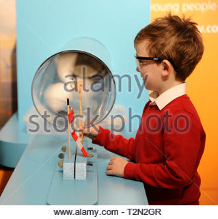 Edinburgh, UK. 3rd April, 2019.  Edinburgh, UK. 3rd April, 2019.  Colin from Royal Mile Primary School trying out wind turbine exhibits at ÒEnergy Makers Ò a new workshop at the City Art Centre (CAC) presented by the FestivalÕs headline sponsors, EDF Energy. Credit: Roger Gaisford/Alamy Live News - Stock Image