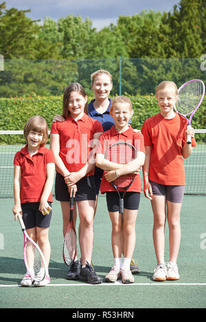 Portrait Of Female School Tennis Team With Coach - Stock Image
