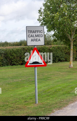 Road sign for traffic calmed area warning of speed humps - Stock Image