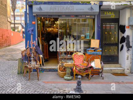 Antique store selling ware on the cobblestone streets of Kadikoy, on the asian side of Istanbul, Turkey - Stock Image