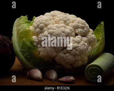 brassica Cauliflower with leek garlic and red onion - Stock Image