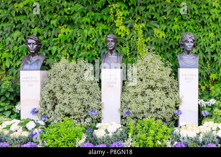 Sculpture busts of British Ladies Champions Angela Mortimer, Ann Jones, Virginia Wade, grounds at Wimbledon All England Lawn Tennis Club, UK - Stock Image