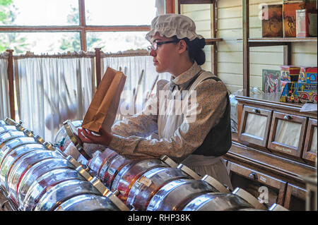 Shop girl selling candy at Heritage Park, Calgary Alberta in the Claresholm General Store {old fashion candy store) - Stock Image