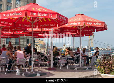 People at a Mcdonalds restaurant by the river in Kiev Ukraine - Stock Image