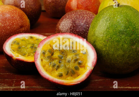 Passion fruits on wooden background - Stock Image