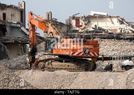 Imperial Tobacco factory, Nottingham, England, UK, Big demolition machine working on site - Stock Image