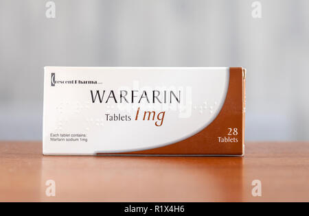 Stock photo of  the front of a box of Warfarin Tablets, 28 x 1g, by Crescent Pharma, with Braille writing.. Warfarin is an anticoagulant medication. - Stock Image