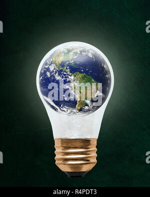 Planet earth inside floating light bulb with copy space. Concept of ecology, environmental conservation; green alternative. Elements of this image pro - Stock Image