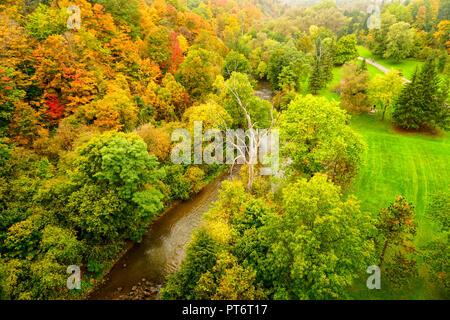 Lush autumn foliage colors along Don River in ET Seton Park in East York, Toronto, Ontario, Canada - Stock Image