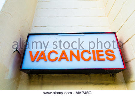 Vacancies sign on a seaside town hotel or B&B (Bed and Breakfast) in Southport, England UK, Orange lettering on a white background, Southport - Stock Image