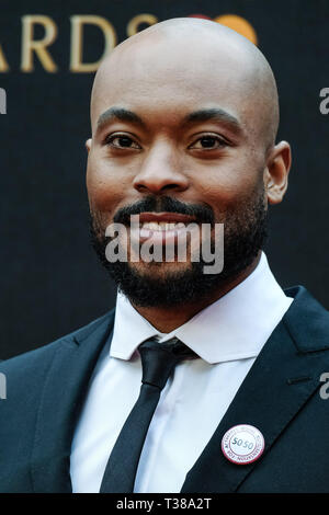 London, UK. 7th Apr 2019. Arinze Kene poses on the red carpet at the Olivier Awards on Sunday 7 April 2019 at Royal Albert Hall, London. Picture by Credit: Julie Edwards/Alamy Live News - Stock Image