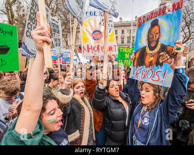 London, UK. 15th Mar 2019. Rallying in Parliament Square - School students go on strike over the lack of action on climate change. They gather in Parliament square and march on Downing Street, blocking the streets around Westminster for over an hour. Credit: Guy Bell/Alamy Live News - Stock Image