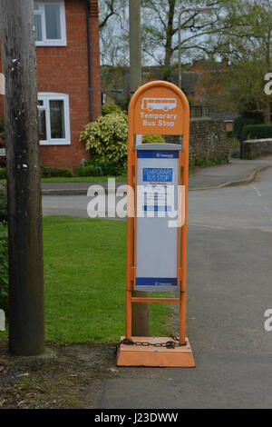 Temporary bus stop on The Bourne, Hook Norton set up whilst roads works are in place - Stock Image
