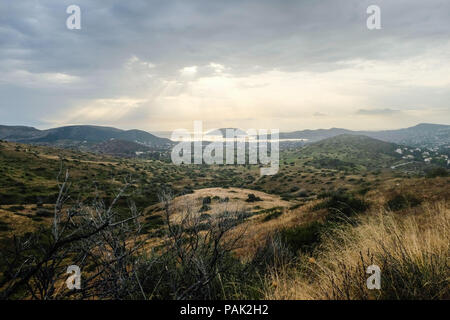 Mountainous landscape looking out towards Fokaia and Saronic Gulf, showing signs of regrowth and adaption from previous wildfire. East Attica, Greece. - Stock Image
