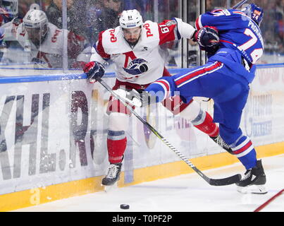 St Petersburg, Russia. 21st Mar, 2019. ST PETERSBURG, RUSSIA - MARCH 21, 2019: HC Lokomotiv Yaroslavl's Nikolai Averin (L) and HC SKA St Petersburg's Nikolai Prokhorkin in action in Leg 5 of their 2018/19 KHL Western Conference semi-final playoff tie, at the Ledovy Dvorets arena. Alexander Demianchuk/TASS Credit: ITAR-TASS News Agency/Alamy Live News - Stock Image