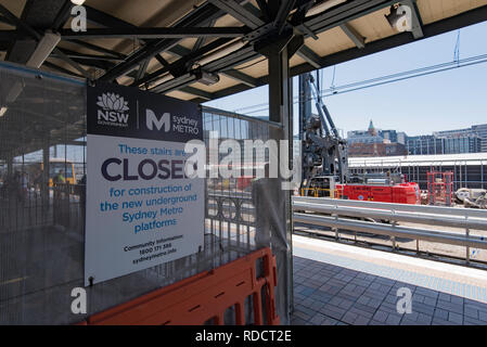 A closed sign at the top of a staircase on a Central Station platform and nearby earthworks, part of the construction of the new Sydney  Metro line - Stock Image
