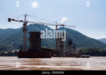 Construction of new part-built railway bridge to China over the Mekong River seen October 2018. Luang Prabang, Laos, southeast Asia - Stock Image