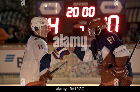 Moscow, Russia. 29th December 2018. Russian President Vladimir Putin, left, and Interros Investment Company President Vladimir Potanin fist bump after a Night Hockey League match at the GUM Department store rink in Red Square December 29, 2018 in Moscow, Russia. Credit: Planetpix/Alamy Live News - Stock Image
