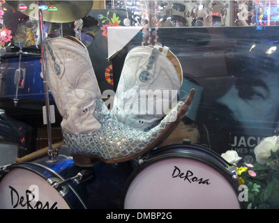 Crazy Rhinestone cowboy boots with long pointed toes in a store window in Nashville, TN, USA - Stock Image