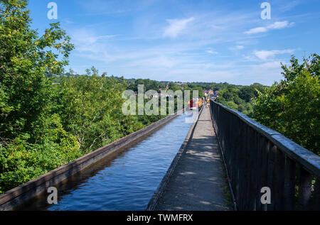 Narrow boat on the Pontcysyllte Aqueduct, which carries the Llangollen Canal across the River Dee in north east Wales in the UK - Stock Image