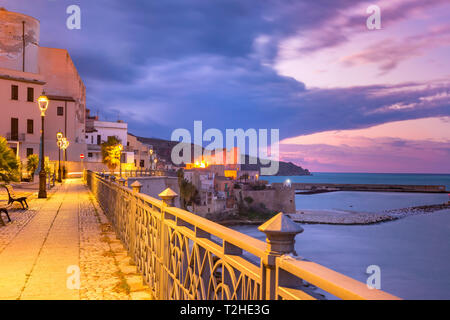 Beautiful view of Piazza Petrolo and medieval fortress in Cala Marina in coastal city Castellammare del Golfo at sunset, Sicily, Italy - Stock Image