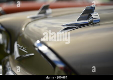 Floral Park, New York, U.S. 27th April, 2014. A warm gray 1957 Chevrelot, with chrome Rocket hood ornaments, is exhibited at the 35th Annual Antique Auto Show at Queens Farm. Credit:  Ann E Parry/Alamy Live News - Stock Image