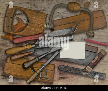 vintage woodworking  tools over wooden bench, business card for your text - Stock Image