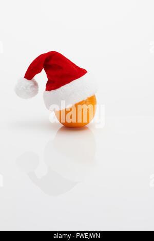 Orange with Christmas Hat - Stock Image