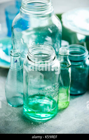 green glass, dinnerware, turquoise color - Stock Image
