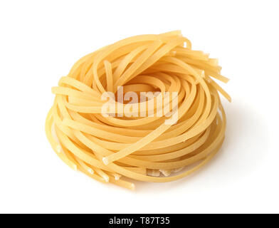 Uncooked tagliolini pasta nest isolated on white - Stock Image