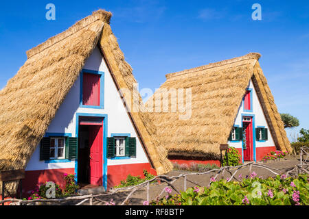 Santana Madeira Palheiro house Traditional triangular A-framed Palheiro Houses Santana Madeira Portugal red blue and white painted house portuguese - Stock Image