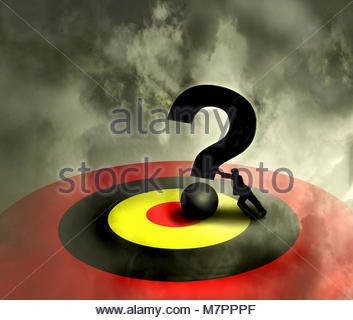 Businessman pushing large question mark into bull's-eye on target - Stock Image