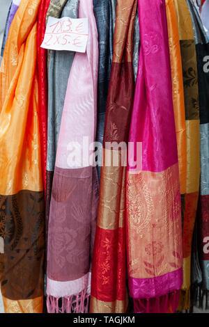 Scarves on sale, Granada, Spain - Stock Image