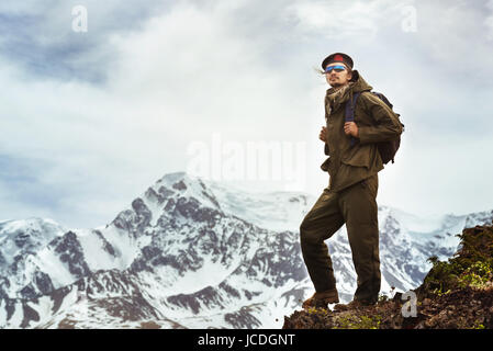 Traveller on mountains top . Travel concept - Stock Image
