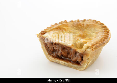 Savoury meat pie with a beef filling studio isolated - Stock Image
