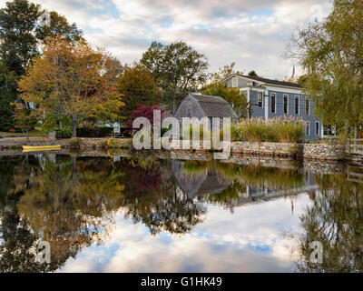 Dexter Grist Mill, Sandwich MA Cape Cod Massachusetts USA seen across the millpond in autumn fall colors colours - Stock Image