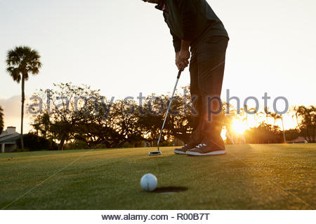 Young man on a golf course - Stock Image