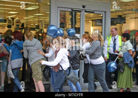 The sales, with young female shoppers queuing and rushing into Primark, Derby, UK - Stock Image