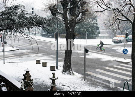 Strasbourg, Alsace, France, snowy street, bicyclist, - Stock Image